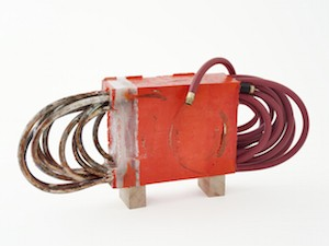 The Imperfective_2013_42L x 7W x 18H_garden hoses, urethane resin